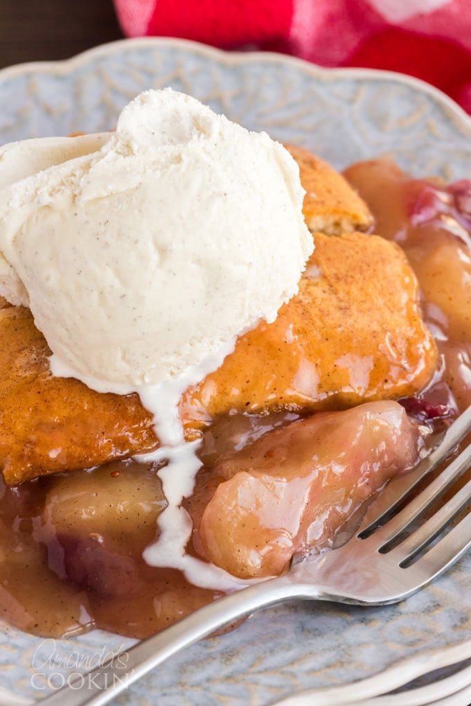 slice of apple crisp with melting vanilla ice cream on top