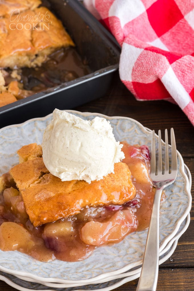 slice of apple crisp with cranberries topped with ice cream