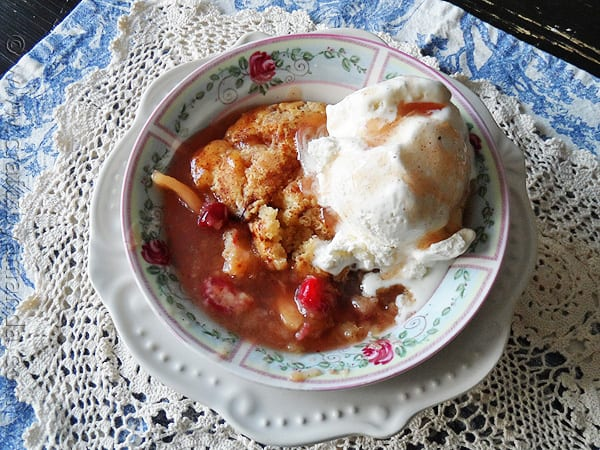 A delicious Apple Cranberry Crisp served warm with vanilla ice cream from @amandaformaro AmandasCookin.com