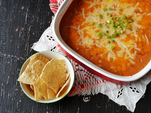 Bean Dip Recipe: Creamy Con Queso Bean Dip for the big game! AmandasCookin.com @amandaformaro
