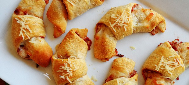 A close up photo of pizza crescent roll ups.