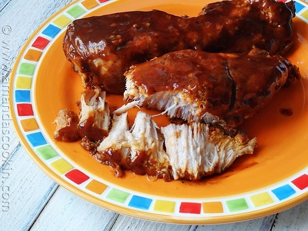A close up photo of slow cooker barbecued country style ribs on a plate.