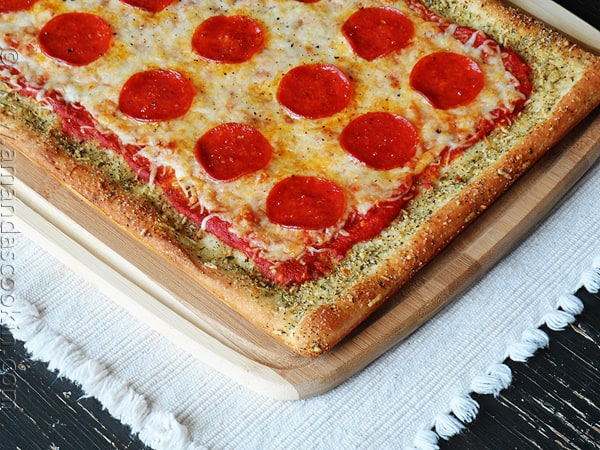 A close up photo of garlic bread crusted classic pizza.