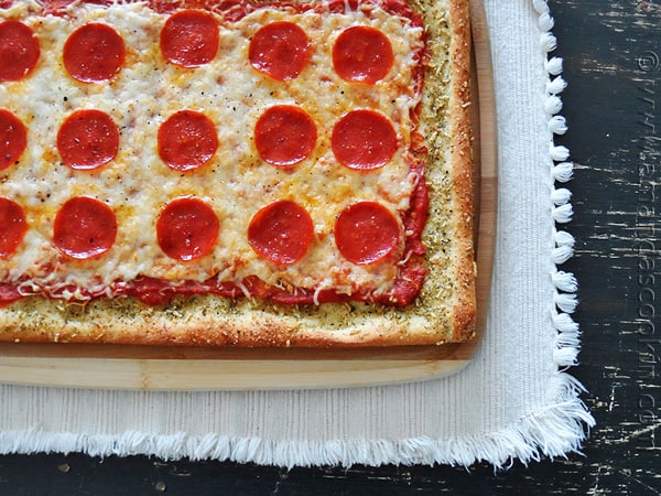 An overhead photo of garlic bread crusted classic pizza.