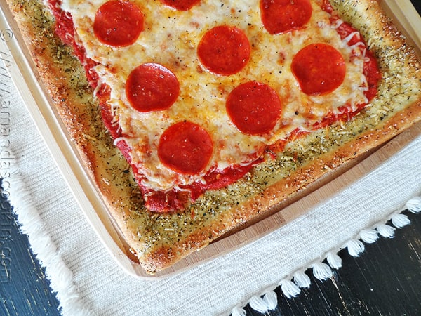 A close up overhead photo of garlic bread crusted classic pizza.