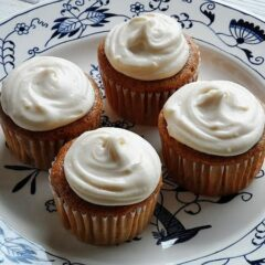 A close up photo of four time saver carrot cupcakes on a plate.