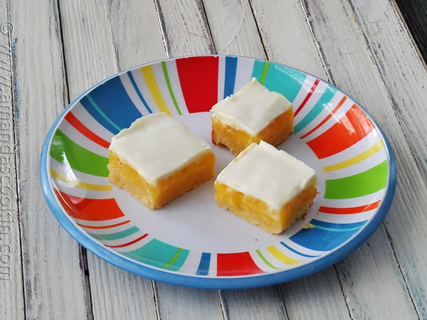 Lemon Bars with Sweet Sour Cream Topping via AmandasCookin.com @amandaformaro