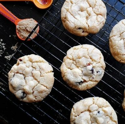 An overhead photo of cherry white chocolate chip cookies on a cooling rack.