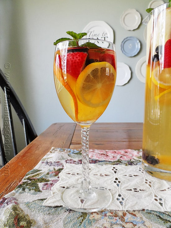 White Moscato Sangria in wine glass with fruit
