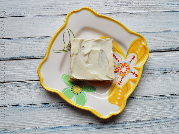 Banana Bars with Vanilla Cream Cheese Frosting by AmandasCookin.com @amandaformaro