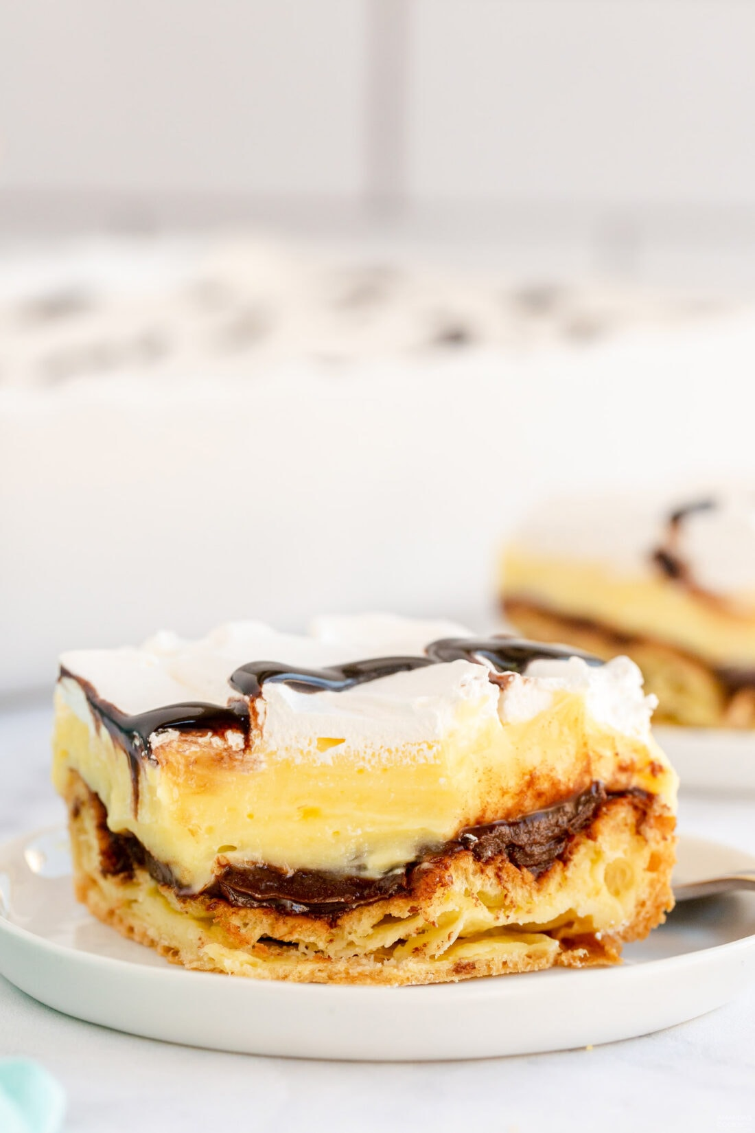 slice of Cream Puff Chocolate Eclair Cake on plate