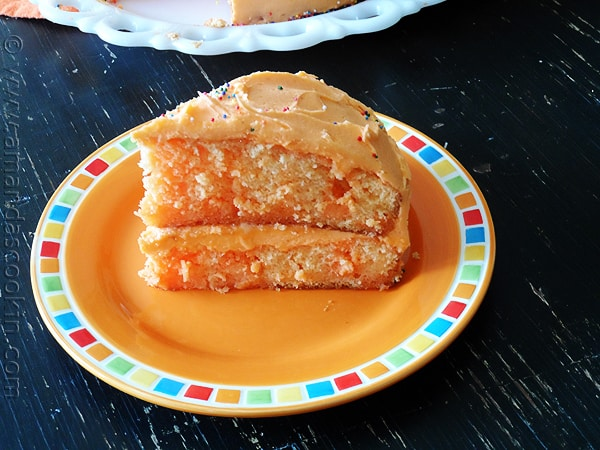 Orange Poke Cake from AmandasCookin.com @amandaformaro