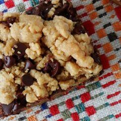 A close up overhead photo of a peanut butter chocolate layer bar.