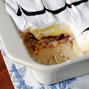 Cream Puff Chocolate Eclair Cake at AmandasCookin.com @amandaformaro