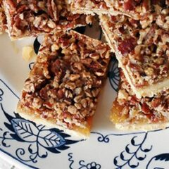 A close up overhead photo of pecan pie bars on a plate.