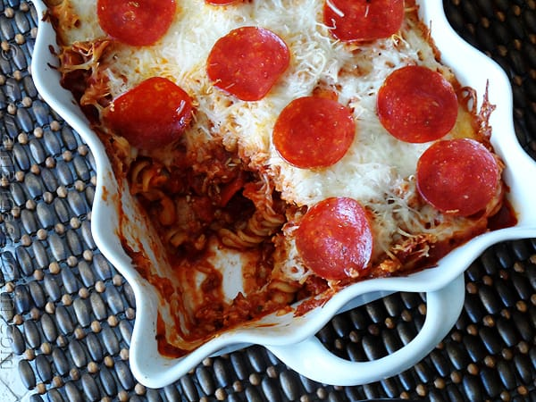 Sausage & Pepperoni Pizza Casserole - AmandasCookin.com @amandaformaro