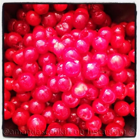 A close up photo of maraschino cherries.