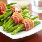 Green beans wrapped in bacon! You can use this same wrapping technique on fresh asparagus, bell pepper strips and even corn on the cob for a delectable spin on appetizers! http://mvb.me/s/1af0f6