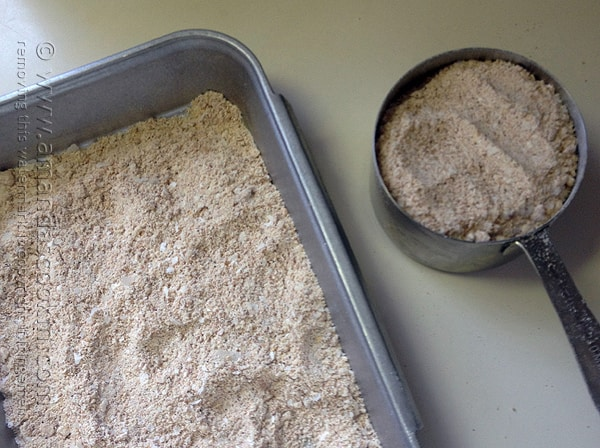 An overhead photo of breading mixture in a shallow pan.