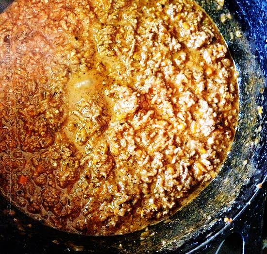 An overhead photo of Bolognese sauce in a Dutch oven.