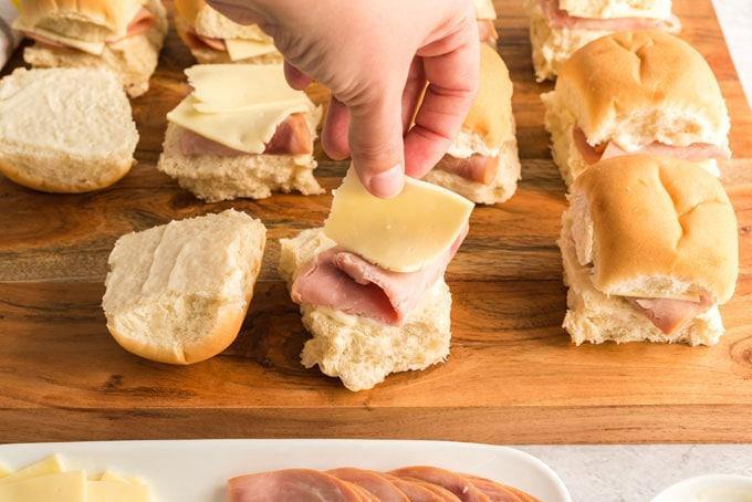 adding cheese to slider
