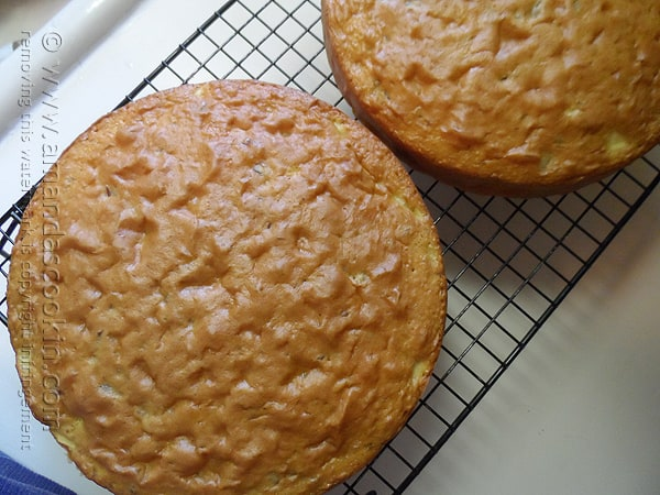 An overhead photo of two Merryfield apple cakes on a cooling rack.
