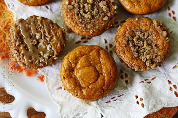 A close up overhead photo of pumpkin mini cakes with cinnamon streusel topping.