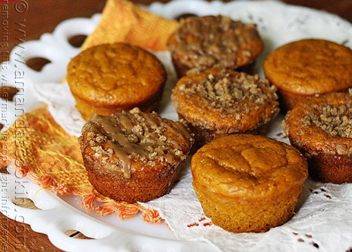 A plate of pumpkin mini cakes with cinnamon streusel topping.