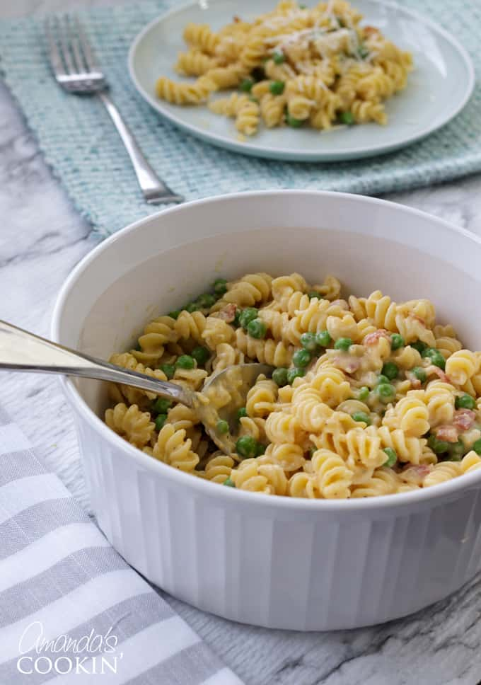bowl of rotini with peas and cheese