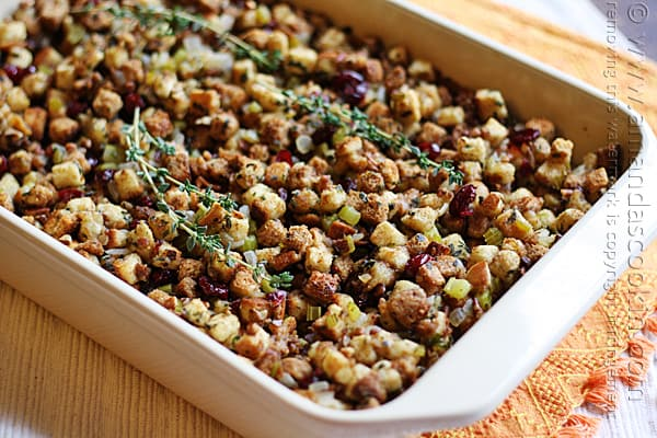 A close up of a pan of stuffing with parsley, sage, rosemary and thyme.