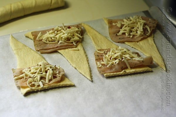 adding turkey and cheese to crescents