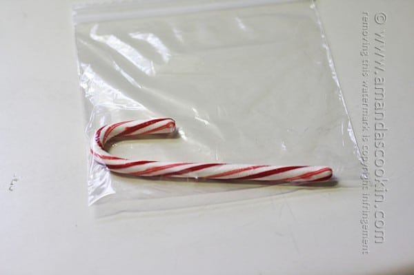 A photo of a candy cane in a clear bag.