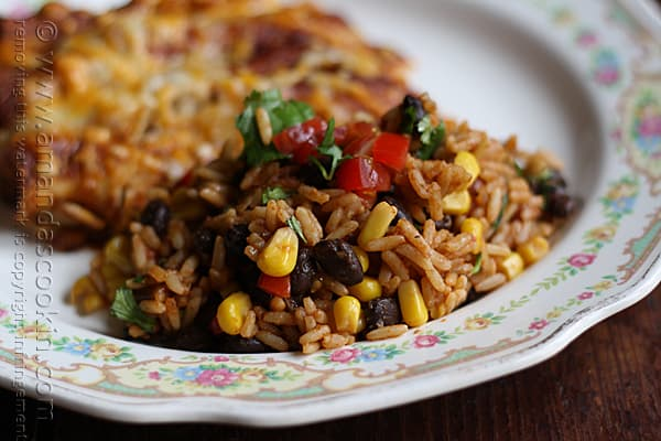 A close up photo of Spanish rice with black beans and corn.