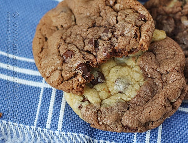 A close up photo of two pretzel chocolate chip cookies resting on a napkin.
