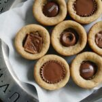 An overhead close up photo of candy bar peanut butter cookie cups.