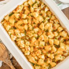 overhead shot of cheese potatoes in a casserole dish