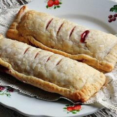 A close up photo of two McDonalds cherry pie copycats on a plate.