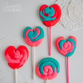 These Valentine Play Dough Cookie Pops are a fun colorful treat for the kids to help make and give to their friends or teacher. Shape them into hearts for an even more special Valentine's Day cookie pop!
