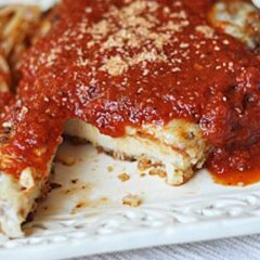 A close up photo of chicken parmesan.
