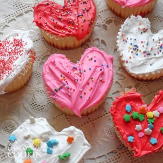 These heart cupcakes are shaped like hearts and covered in white, pink and red frosting. Make these super easy Valentine cupcakes from scratch or a box!