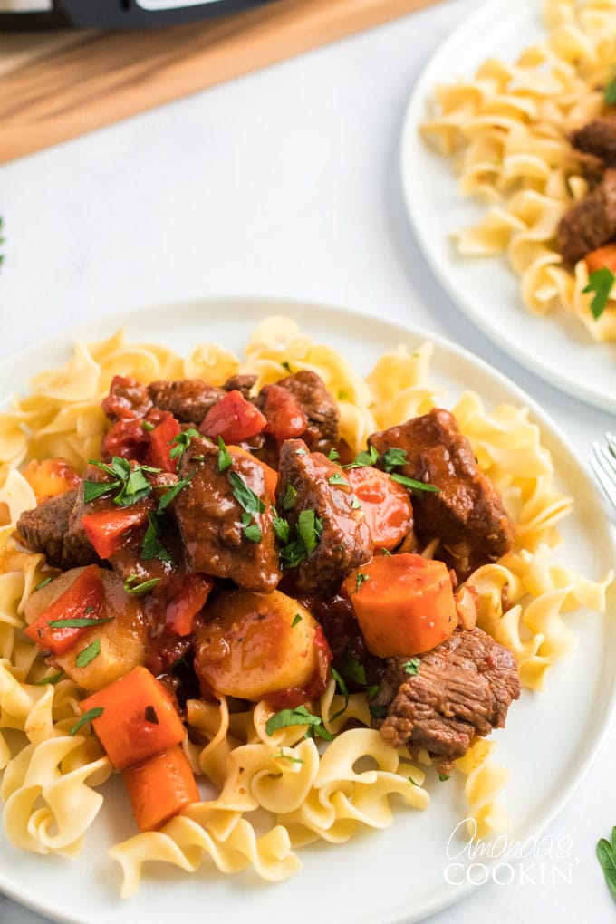 plate of Hungarian goulash over egg noodles