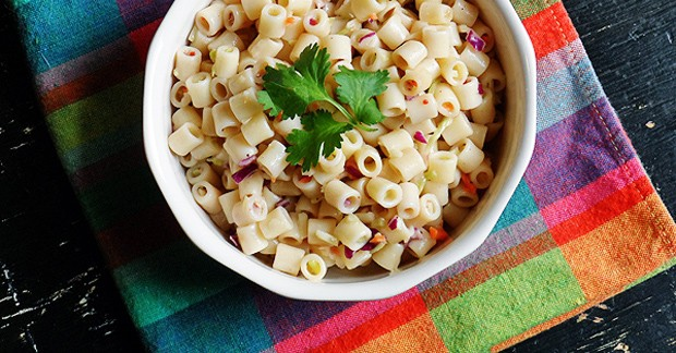 A close up overhead of three ingredient quick pasta salad in a bowl with fresh parley on top.