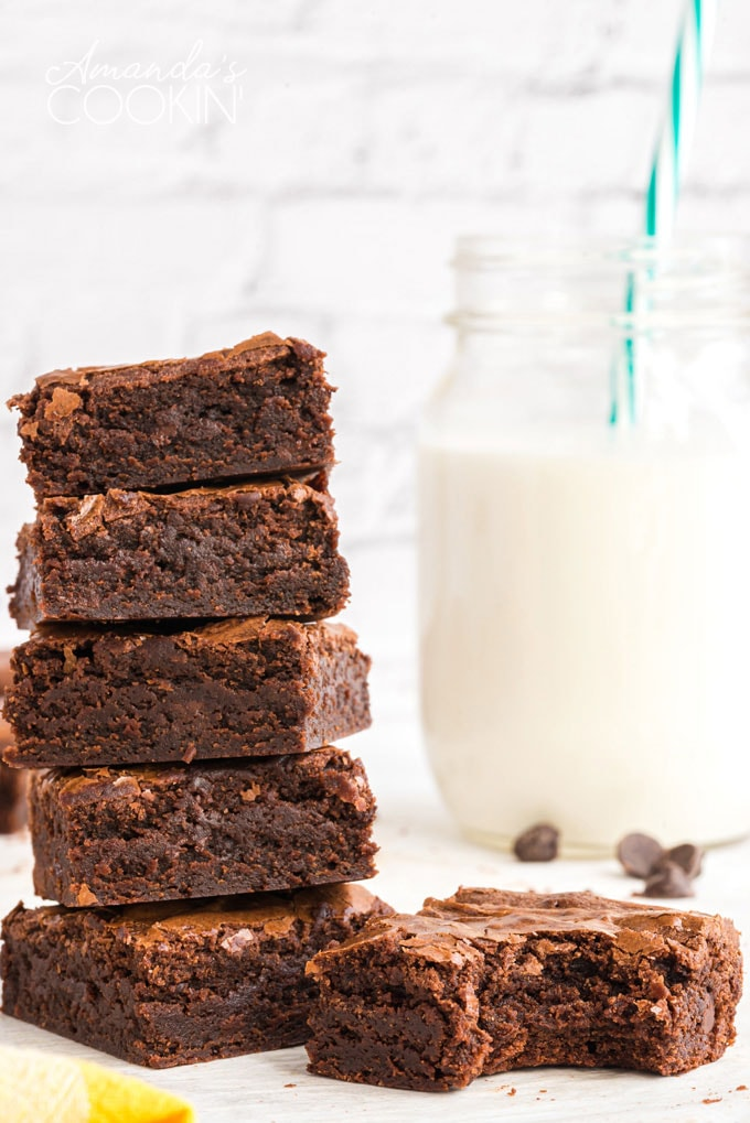 stack of brownies with bottle of milk