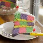 This Checkerboard Cake is the perfect treat for Easter- impress your friends and family with a colorful cake for the holiday!