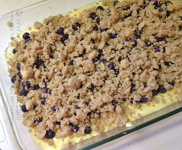 Sprinkle the sugar topping over the blueberries on the cake batter