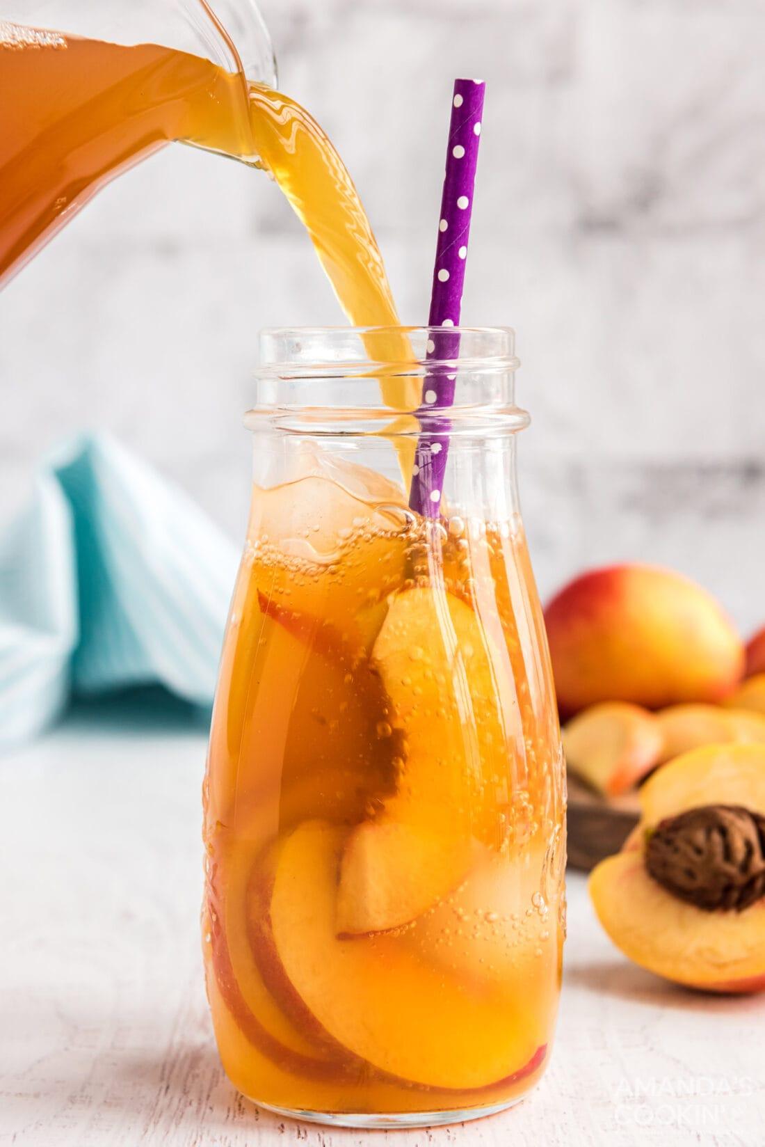 pouring peach tea