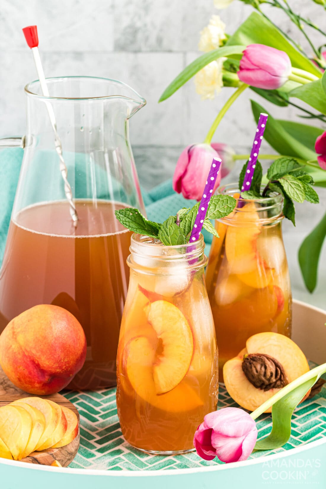 two bottles of peach iced tea