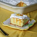 Lemon Desserts: Citrus Lover's Poke Cake by Amanda Formaro of Amanda's Cookin'