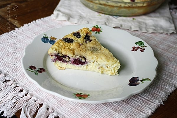 A slice of blackberry coconut impossible pie on a plate.