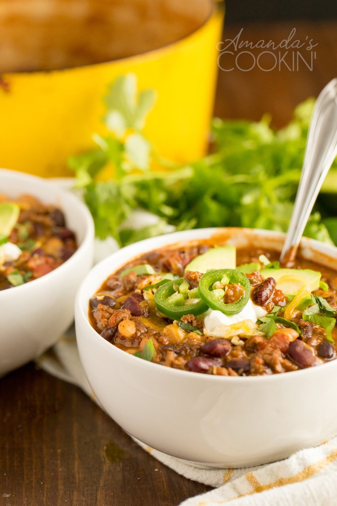bowl of chili with avocado and jalapeno garnish
